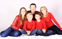 color photo of family group in red shirts
